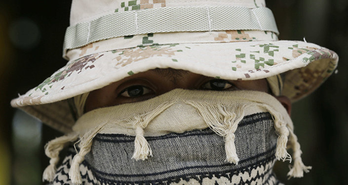 A Colombian Army Special Forces soldier waits to take part in a show of military exercises at the Tolemaida military base