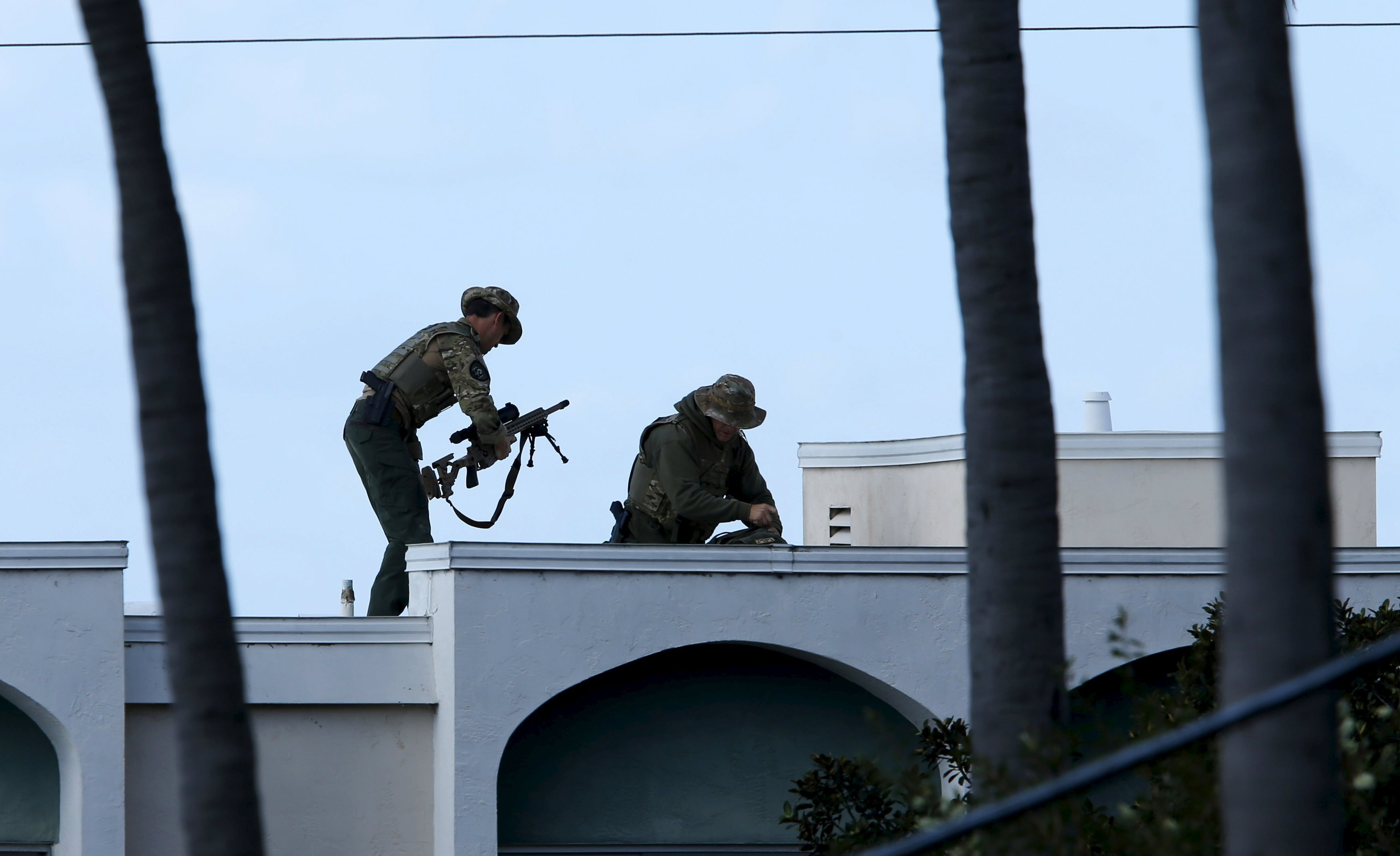 SWAT team officers set up their position at the scene of an active shooting with a suspect with a high powered rifle in the Bankers Hills section of San Diego, California, November 4, 2015.