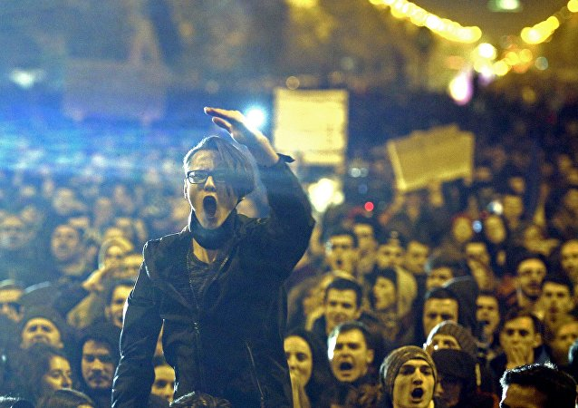 A demonstrator shouts anti corruption slogans during a street protest in Bucharest, Romania November 4, 2015.