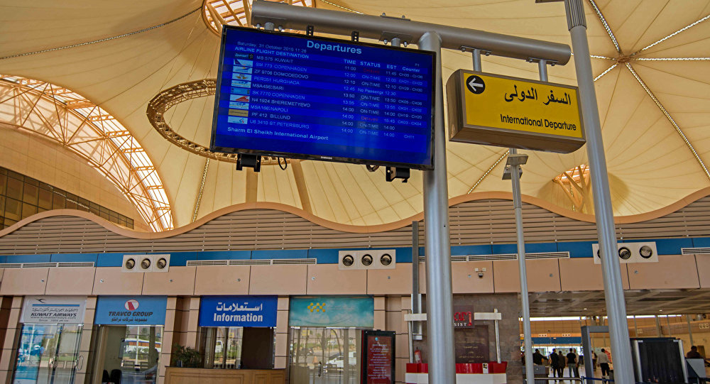 A signboard list scheduled flights departing from Sharm el-Sheikh Airport