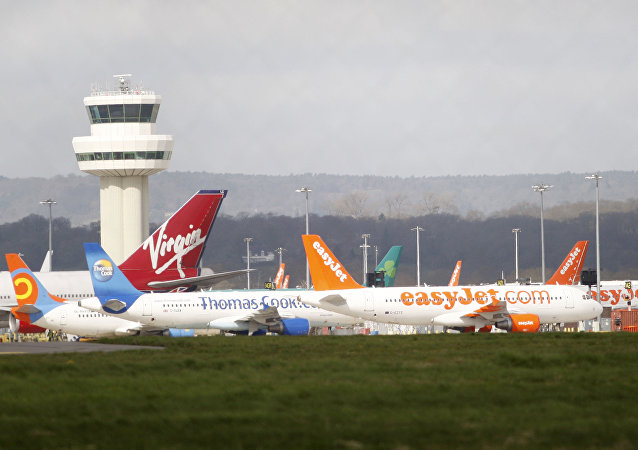 Airplanes stand idle at London's Gatwick Airport, England