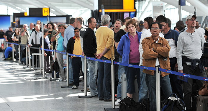 Passengers wait in line for delayed British Airways flights inside Heathrow Airport in London. (File)