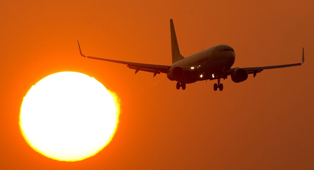 A Boeing 737 flies at the airport Stuttgart, southern Germany, as sun downs on March 14, 2014