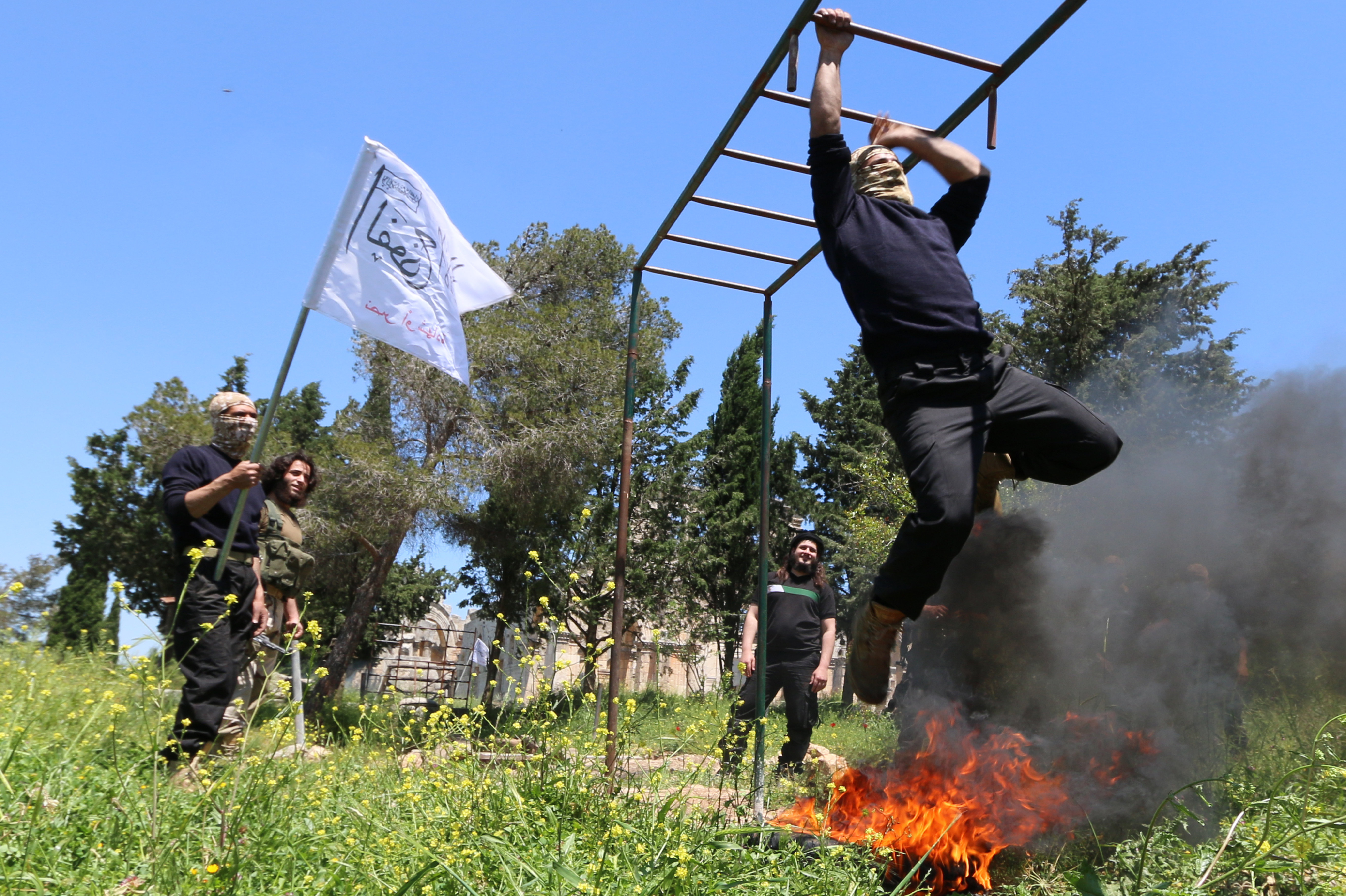 Rebel fighters from the First Battalion under the Free Syrian Army take part in a military training on May 4, 2015, in the rebel-held countryside of the northern city of Aleppo
