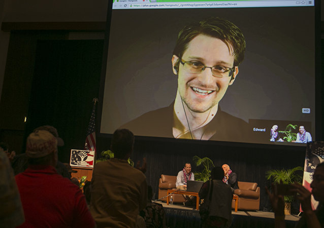National Security Agency leaker Edward Snowden appears on a live video feed broadcast from Moscow at an event sponsored by the ACLU Hawaii in Honolulu on Saturday, Feb. 14, 2015
