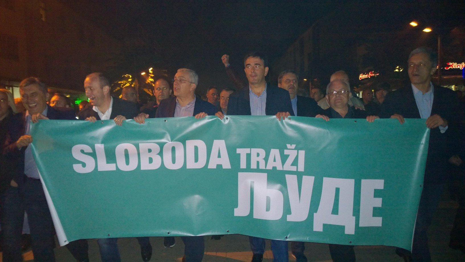 """The Opposition leaders are carrying a big banner reading """"Freedom Calling Me!"""""""