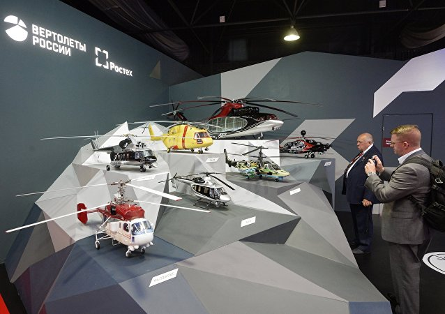 Visitors at the Russian Helicopters stand at the MAKS-2015 air show in Zhukovsky in the Moscow Region