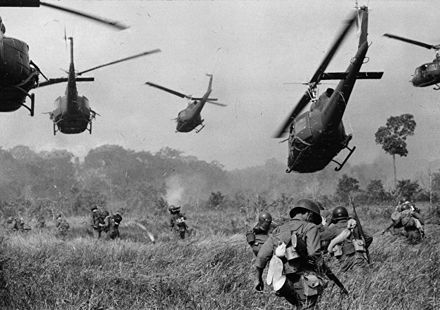 Hovering U.S. Army helicopters pour machine gun fire into the tree line to cover the advance of South Vietnamese ground troops in an attack on a Viet Cong camp 18 miles north of Tay Ninh, northwest of Saigon near the Cambodian border, in March 1965 during the Vietnam War
