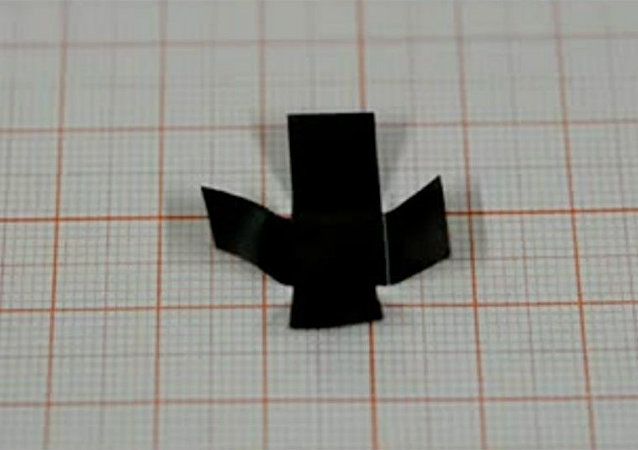 A plus sign–shaped piece of graphene paper can fold into a box when researchers hit it with light
