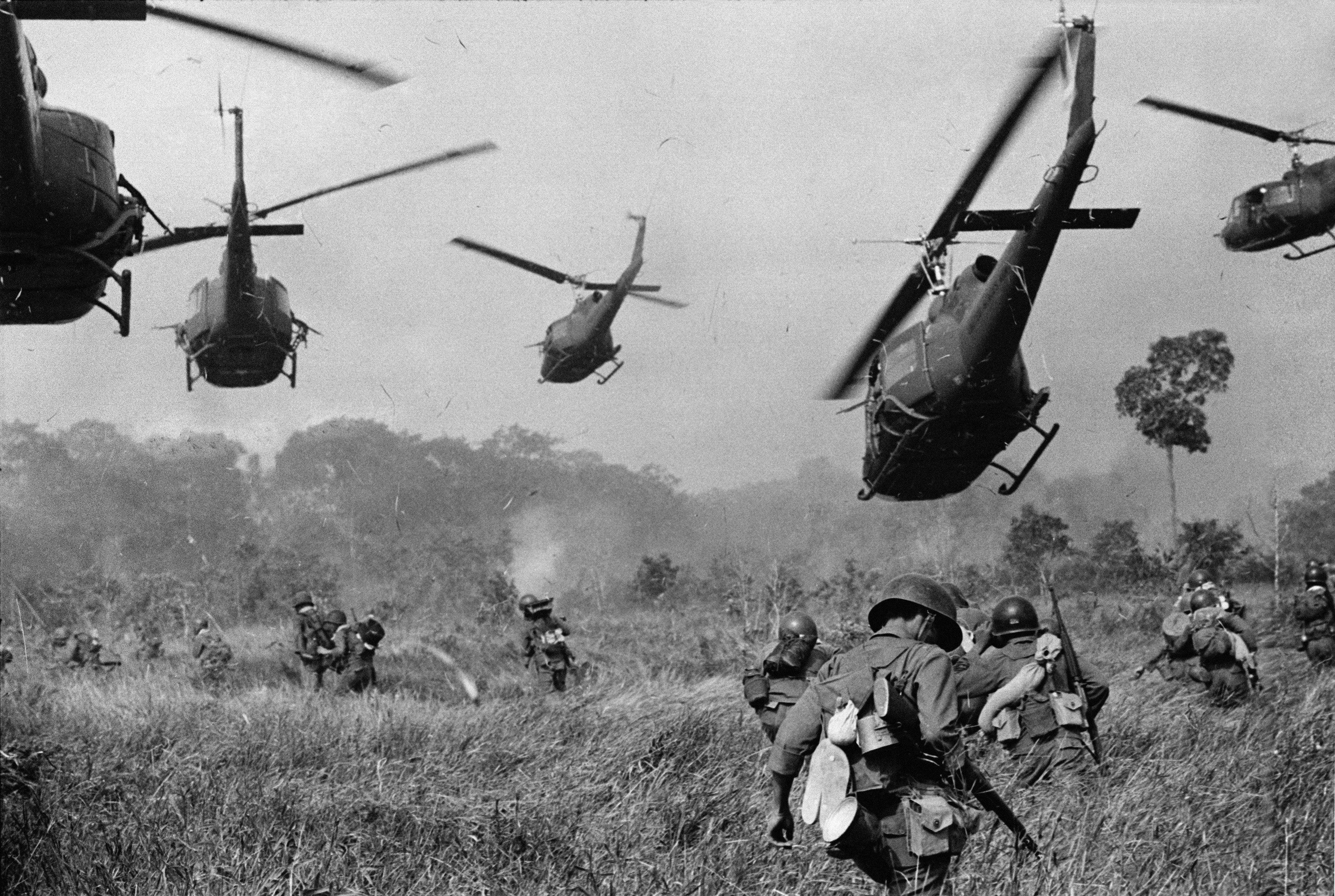 U.S. Army helicopters pour machine gun fire into the tree line to cover the advance of South Vietnamese ground troops in an attack on a Viet Cong camp 18 miles north of Tay Ninh, northwest of Saigon, March 1965.