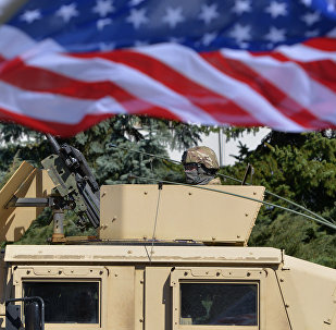 A US soldier looks from the armored vehicle Humvee as US military convoy arrives to the Czech army barracks on March 30, 2015 in Prague after entering the Czech Republic at the border crossing in Harrachov on the way from Baltic countries to base in Vilseck, southern Germany