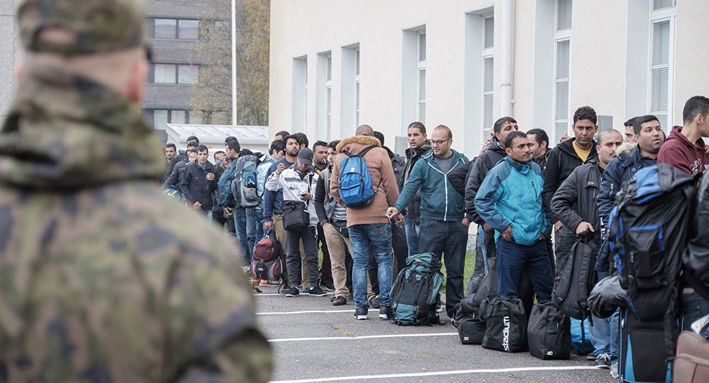Asylum seekers queue up as they arrive at a refugee reception centre in the northern town of Tornio, Finland, on Friday Sept. 25, 2015
