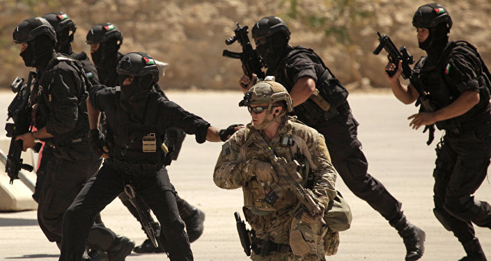 FILE - In this Thursday, June 20, 2013 photo, special operations forces from Iraq, Jordan and the U.S. conduct an exercise as part of Eager Lion multinational military maneuvers at the King Abdullah Special Operations Training Center (KASOTC) in Amman, Jordan