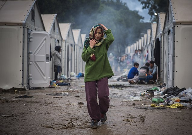 A troubled woman in a migrant camp