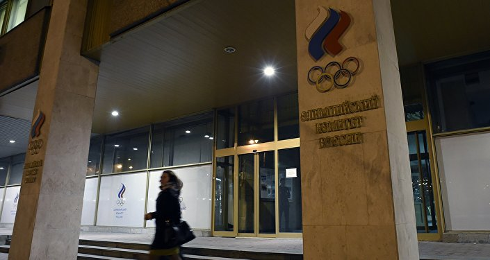 Women leave the Russian Olympic Committee building which houses the headquarters of the All-Russian Athletics Federation in Moscow on November 9, 2015