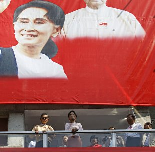 Myanmar's National League for Democracy party leader Aung San Suu Kyi speaks to supporters about the general elections in Yangon, Myanmar November 9, 2015