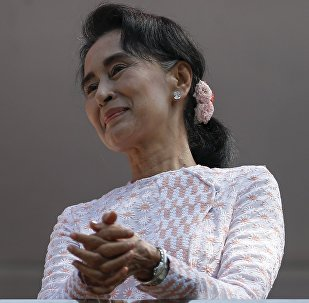 Myanmar's National League for Democracy party leader Suu Kyi looks at supporters after speaking about the general elections in Yangon