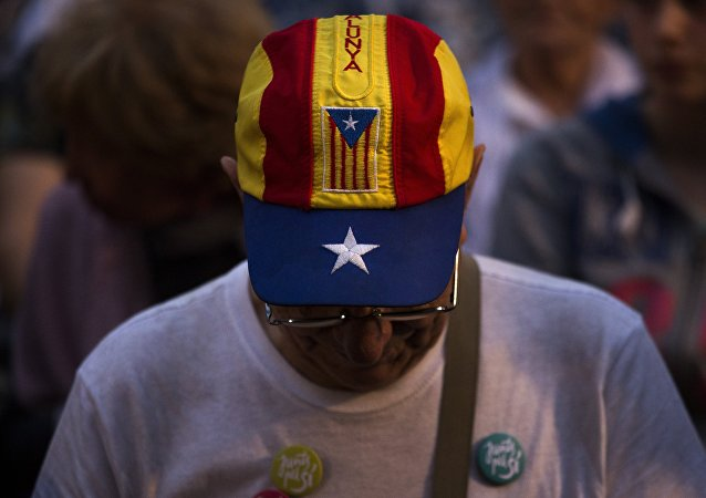 In this Wednesday, Sept. 23, 2015 photo, a pro independence supporter attends a rally of Junts pel Si or Together for YES in Barcelona, Spain.