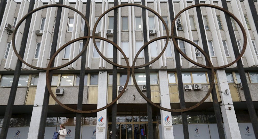 A woman walks out of the Russian Olympic Committee headquarters building, which also houses the management of Russian Athletics Federation in Moscow, Russia, November 13, 2015