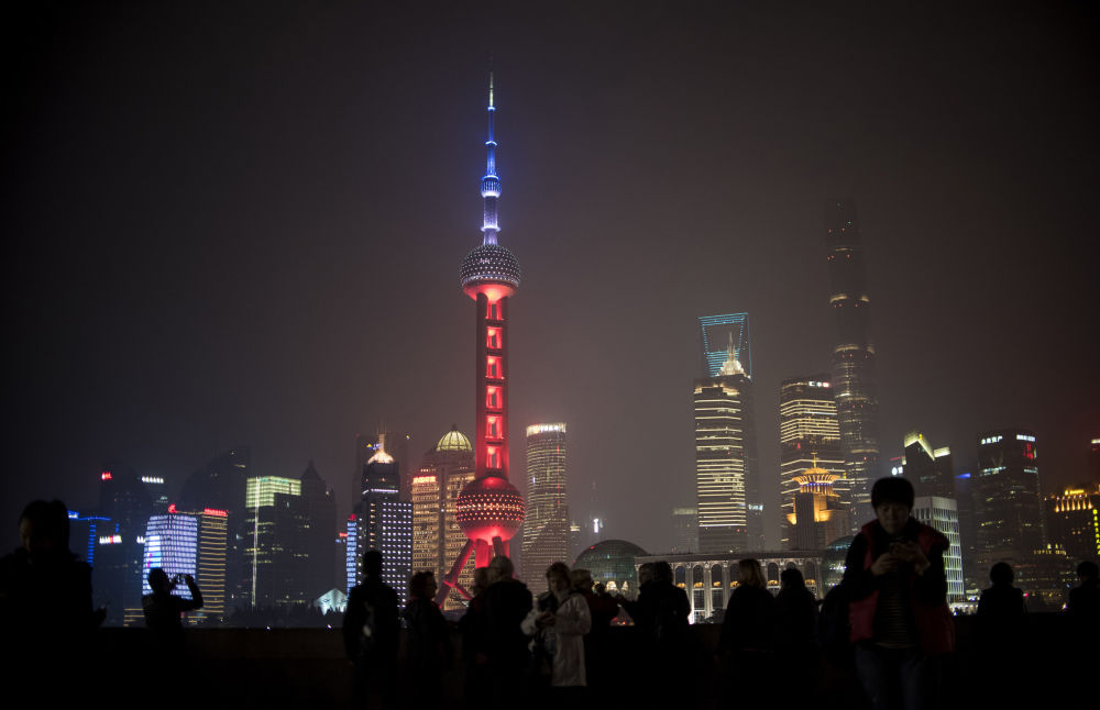 The Oriental Pearl TV Tower in Shanghai, China, was lit in red, white and blue for one hour, resembling the colors of the French flag, as the Chinese expressed their solidarity with France after eight extremists wearing explosive belts attacked several venues across Paris, killing 129 people.