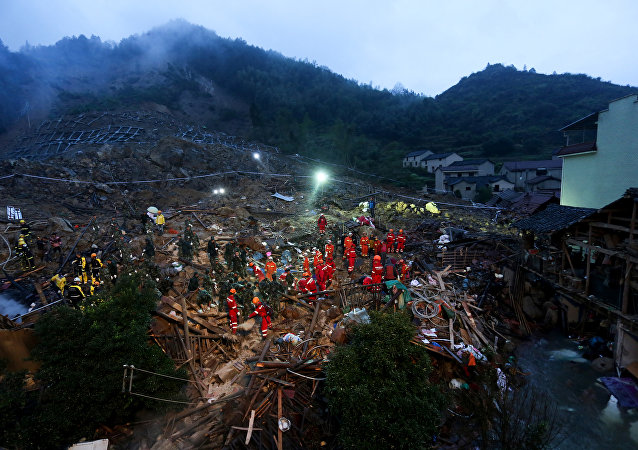 Rescuers search for survivors after a landslide in Lishui, east China's Zhejiang province on November 14, 2015. Seven people were confirmed dead and 30 others remained missing after a landslide hit a village in east China's Zhejiang province on November 13, local media reported