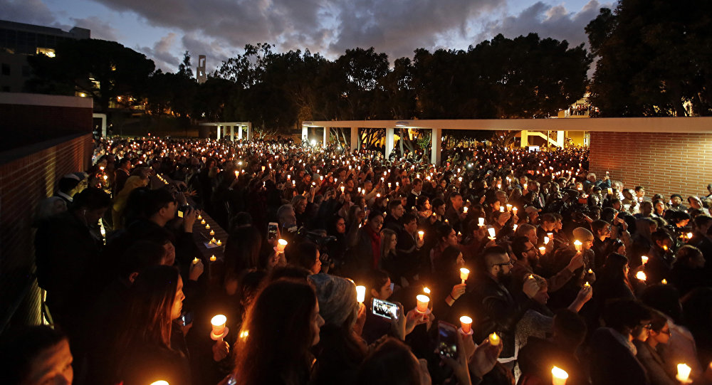 Well-wishers hold up candles during a memorial service for California State Long Beach student Nohemi Gonzalez on Sunday, Nov. 15, 2015 in Long Beach, Calif., who was killed at restaurant in Paris on Friday night during the terrorist attacks