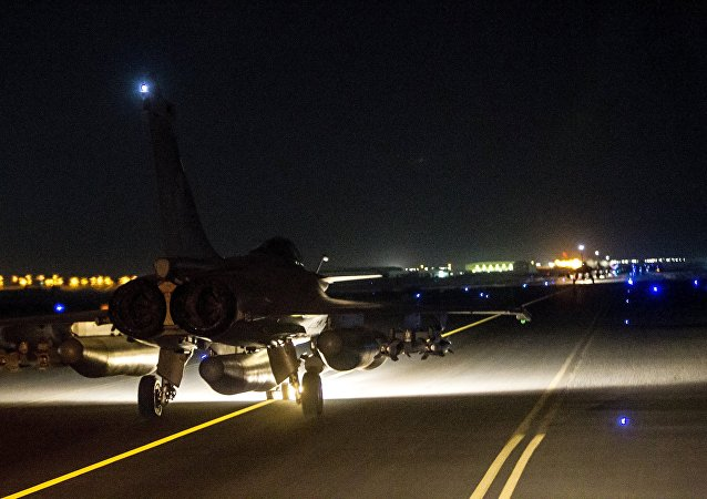 A French fighter jet taxis along the runway in an undisclosed location, in this handout picture released by the ECPAD late November 15, 2015
