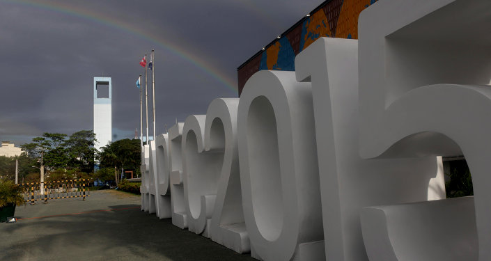A rainbow appears outside the International Media Center in Manila, Philippines Sunday Nov. 15, 2015