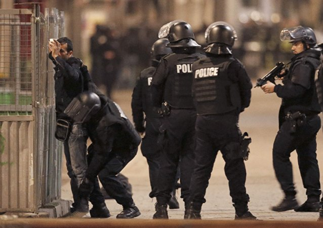 French spolice stop and search a local resident as shots are exchanged in Saint-Denis, France, near Paris, November 18, 2015 during an operation to catch fugitives from Friday night's deadly attacks in the French capital