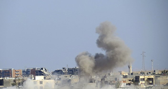 n this file photo smoke is seen risisng from Daesh positions following a US-led coalition airstrike