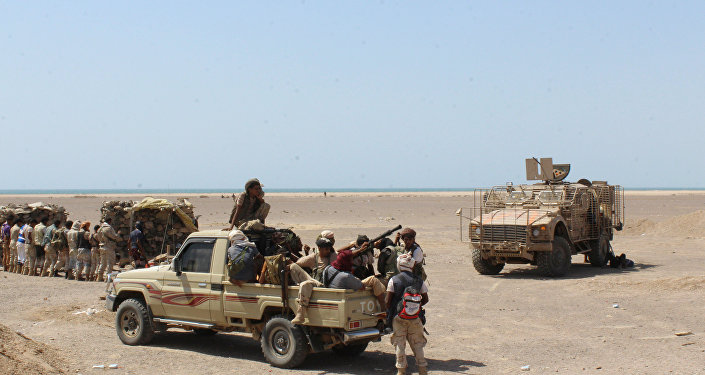 Fighters against Shiite rebels known as Houthis gather in the strait of Bab al-Mandab, west of the southern port city of Aden.