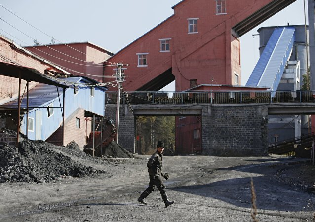 A miner walks at a coal mine, China