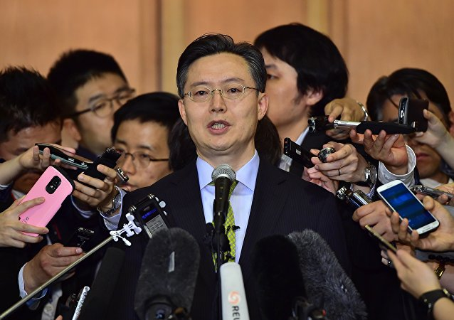 Hwang Joon-Kook (C), South Korean special representative for Korean Peninsula peace and security affairs, speaks to the media after a meeting with his Japanese counterpart Junichi Ihara and US counterpart Sung Kim at a hotel in Seoul on May 27, 2015