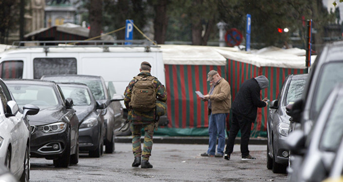 A Belgian Army soldier patrols near a street market at the Sablon District in Brussels on Saturday, Nov. 21, 2015