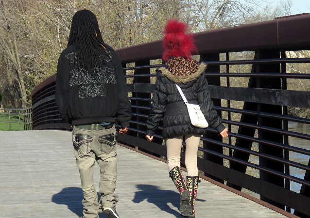 A couple crosses a bridge in Forest Park, Illinois