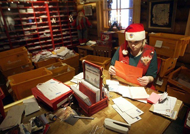 Santa's busy helper opening children's letters from all over the world in Santa Claus' Main Post Office at the Arctic Circle near Rovaniemi, Finnish Lapland