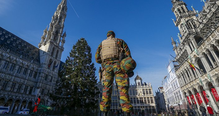 A Belgian soldier patrols in Brussels' Grand Place as police searched the area during a continued high level of security following the recent deadly Paris attacks.