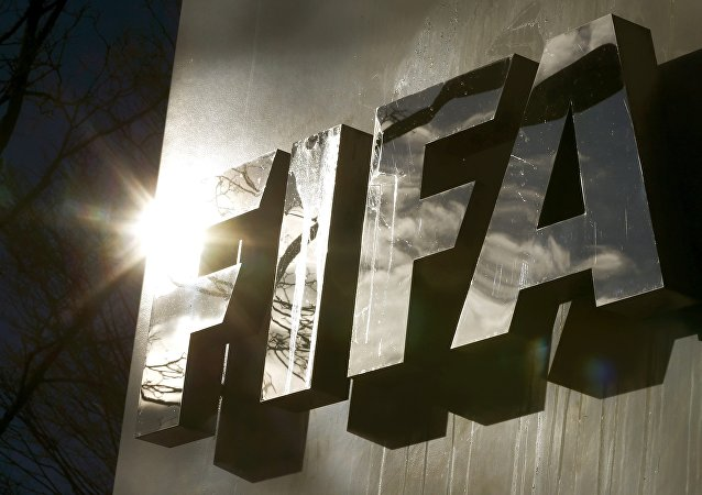 The sun is reflected in FIFA's logo.