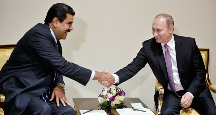 Russian President Vladimir Putin, right, and Venezuelan President Nicolas Maduro during their meeting in Tehran, Iran, November 23, 2015
