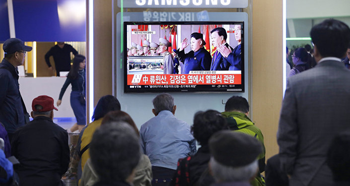 South Koreans watch a TV news program showing North Korean leader Kim Jong Un, third from right, during a ceremony to mark the 70th anniversary of the country's ruling party in Pyongyang, at Seoul Railway Station in Seoul, South Korea. Saturday, Oct. 10, 2015
