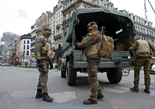 Belgian soldiers patrol in central Brussels as police search the area during a continued high level of security following the recent deadly Paris attacks, Belgium, November 24, 2015