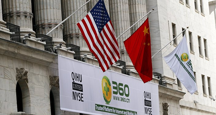 A sign advertising the Qihoo 360 Technology Co Ltd is hung with the U.S. and Chinese flags outside of the New York Stock Exchange before the company's Initial Public Offering (IPO) in New York in this March 30, 2011 file picture