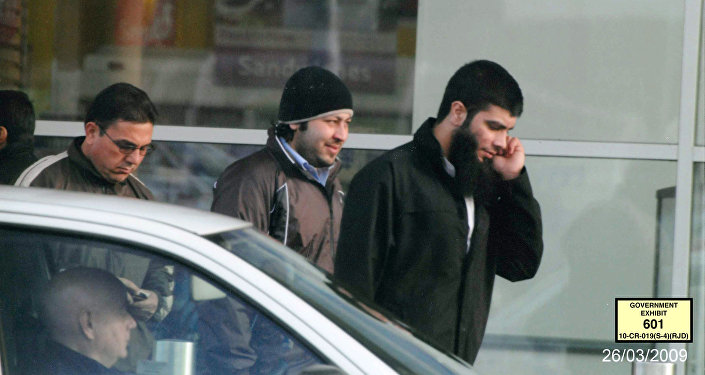 In this image taken from surveillance video on March 26, 2009, and provided by the United States Attorney's Office, Abid Naseer, right, talks on a cell phone while walking along a street in Manchester, England