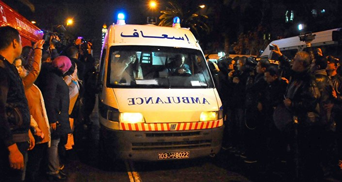An ambulance rushes to the scene of a bus explosion in the center of the capital, Tunis, Tunisia, Tuesday, Nov. 24, 2015.
