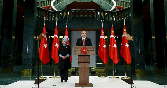 Turkish President Tayyip Erdogan, accompanied by his wife Emine Erdogan, adressess teachers during a reception at the Presidential Palace in Ankara, Turkey, November 24, 2015