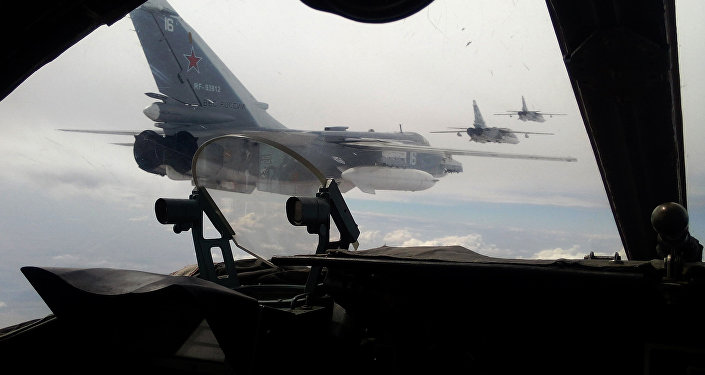 Russian Air Force Su-24 bombers fly during a military exercise in southern Russia on February 11, 2015