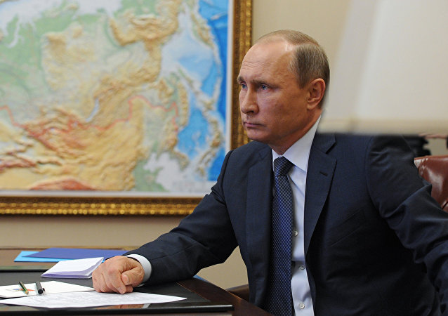 Russian President Vladimir Putin holds a video conference with Russian military personnel engaged in the Syria operation