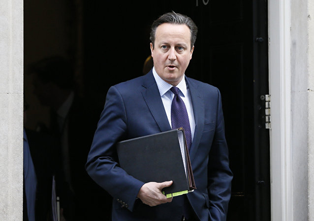 Britain's Prime Minister David Cameron leaves 10 Downing Street to attend Parliament in London, Thursday, Nov. 26, 2015.