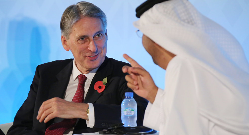 British Foreign Secretary Philip Hammond (left)