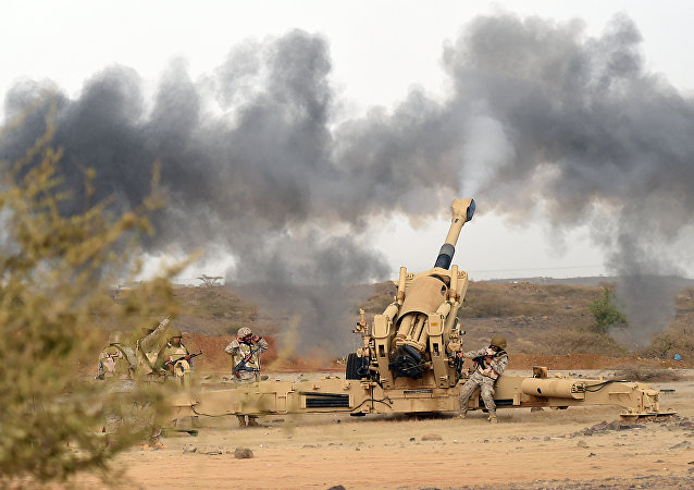 Saudi army artillery fire shells towards Yemen from a post close to the Saudi-Yemeni border, in southwestern Saudi Arabia, on April 13, 2015
